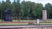 People are visiting the museum in former Nazi Death Camp Stutthof, in Sztutowo, July 21, 2020. - The pyres of burning bodies in the forests around Nazi Germany's Stutthof concentration camp still haunt 93-year-old Marek Dunin-Wasowicz, a crucial witness in the trial of former SS guard Bruno Dey which is expected to close on July 23, 2020. (Photo by Wojtek RADWANSKI / AFP) (Photo by WOJTEK RADWANSKI/AFP via Getty Images)