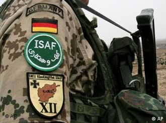 A German soldier in Afghanistan with his German flag and ISAF patches clearly visible