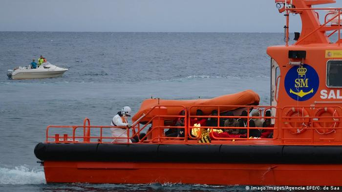 A Spanish Sea Rescue Services ship carries rescued migrants ashore to Fuerteventura