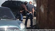 23.07.2020, Ukraine, Poltava: 6293486 23.07.2020 In this handout video grab released by Ukrainian Criminal Investigations directorate, a criminal suspect, left, is taking a hostage in Poltava, Ukraine. On July 23, a man whom police officers tried to detain for stealing a car, was threatening to detonate a grenade and took a senior Ukrainian policeman hostage in the central city of Poltava. Editorial use only, no archive, no commercial use. Criminal Investigations Department of Ukraine Foto: Criminal Investigations Department of Ukraine  