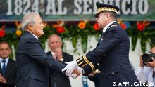 June 5, 2014*** The president of El Salvador, Salvador Sanchez Ceren (L), receives from Salvadorean Defense Minister David Munguia Payes (R) the baton as Commander General of the Salvadorean Armed Forces in a ceremony at the Gerardo Barrios military Academy in San Salvador, El Salvador on June 5, 2014. Salvador Sanchez Ceren, former commander of the Farabundo Marti National Liberation Front guerrilla, assumed the command of the armed forces. AFP PHOTO/ Jose CABEZAS (Photo by JOSE CABEZAS / AFP)