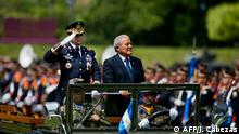 June 5, 2014*** The President of El Salvador, Salvador Sanchez Ceren (R), and Salvadorean Defense Minister David Munguia Payes review troops in a ceremony in which he received the command of the Armed Forces at the Gerardo Barrios military Academy in San Salvador, El Salvador on June 5, 2014. Salvador Sanchez Ceren, former commander of the Farabundo Marti National Liberation Front guerrilla, assumed the command of the armed forces. AFP PHOTO/ Jose CABEZAS (Photo by JOSE CABEZAS / AFP)