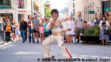 TOPSHOT - Norwegian artist Kjell Elvis (Kjell Henning Bjørnstad) performs in central Oslo in an attempt to beat the record of the world´s longest Elvis Presley singing marathon on July 23, 2020 in Oslo. - His plan is to perform continuously for 50 hours, ending Saturday morning, 25 July. (Photo by Fredrik Hagen / NTB Scanpix / AFP) / Norway OUT (Photo by FREDRIK HAGEN/NTB Scanpix/AFP via Getty Images)