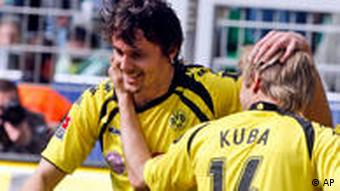 Dortmund's Neven Subotic, left, and Kuba, right, celebrate after scoring the second goal for his team during the German first division Bundesliga soccer match between Borussia Dortmund and Werder Bremen in Dortmund, Germany, Saturday, April 3, 2010.