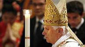 Pope Benedict XVI holds a candle during the Easter vigil mass in St. Peter's Basilica, Rome