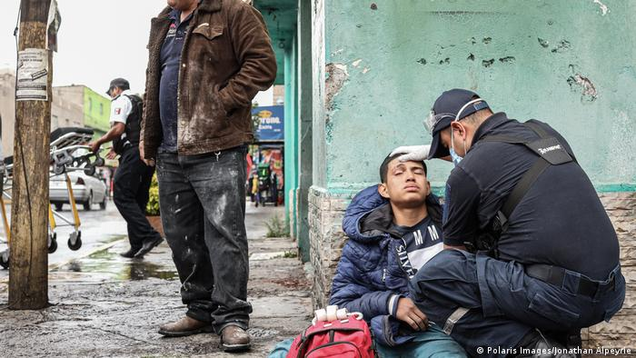 Young man being treated in Nezahualcoyotl (Polaris Images/Jonathan Alpeyrie)