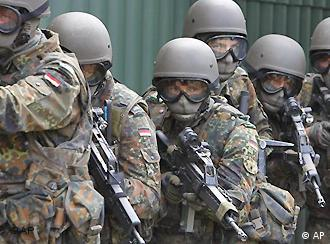German soldiers hold rifles during a drill