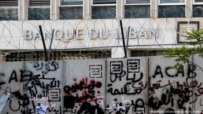 Graffiti covers the walls and barbed wire that surrounds the Central Bank of Lebanon