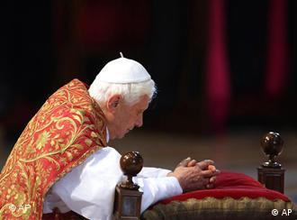 Pope Benedict XVI kneels during a service in St. Peter's Basilica