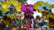 Brazilian Maracatu dancers perform during the traditional Galo da Madrugada (Dawn Rooster) carnival parade along the streets of Sao Paulo, Brazil, on February 25, 2020. (Photo by NELSON ALMEIDA / AFP) (Photo by NELSON ALMEIDA/AFP via Getty Images)