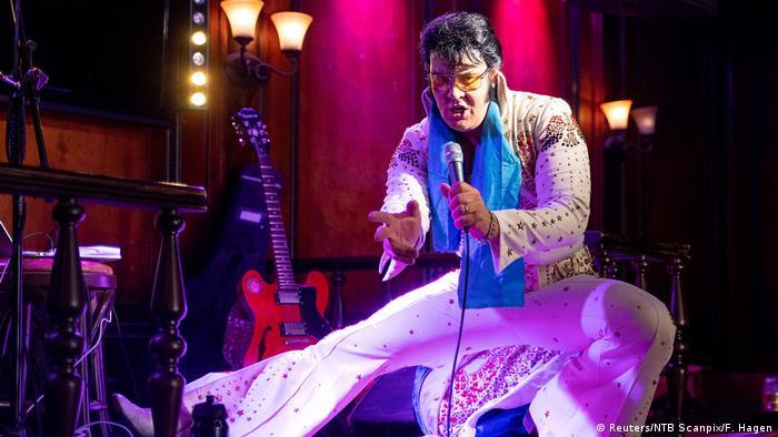 Norwegian artist Kjell Bjornestad impersonating Elvis Presley performs at the start of his challenge
