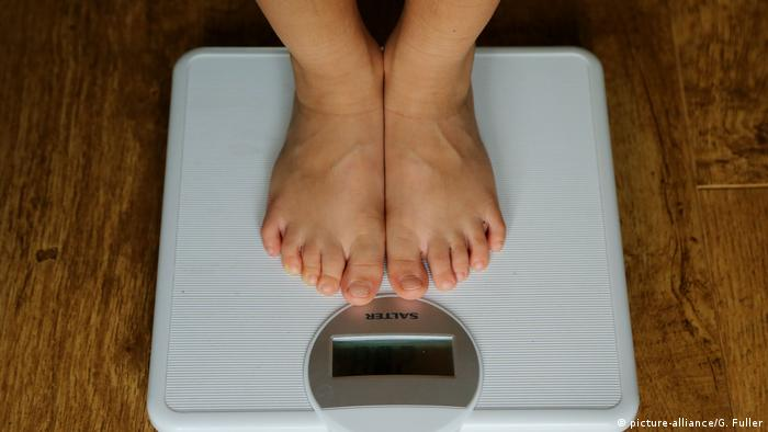 A person standing on a scale