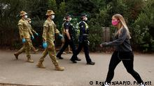 ADF personnel and Victorian police officers patrol a walking track as Melbourne remains in lockdown restrictions due to outbreaks of the coronavirus disease (COVID-19) in Melbourne, Australia, July 26, 2020. Picture taken July 26, 2020. AAP Image/Daniel Pockett via REUTERS ATTENTION EDITORS - THIS IMAGE WAS PROVIDED BY A THIRD PARTY. NO RESALES. NO ARCHIVE. AUSTRALIA OUT. NEW ZEALAND OUT