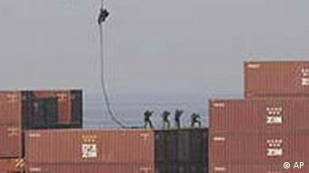 Marines landing on containers on the ship