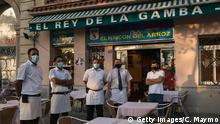 27.07.2020 *** BARCELONA, SPAIN - JULY 27: The staff of El Rey de la Gamba 2 restaurant poses for photos outside their restaurant on July 27, 2020 in Barcelona, Spain. Spanish officials insisted it was still safe to travel to the country despite a recent rise in coronavirus (COVID-19) cases, which led the UK government to reimpose a 14-day quarantine on arrivals from Spain. The Catalonian government had recently issued a stay-at-home recommendation that included the regional capital, Barcelona. (Photo by Cesc Maymo/Getty Images)