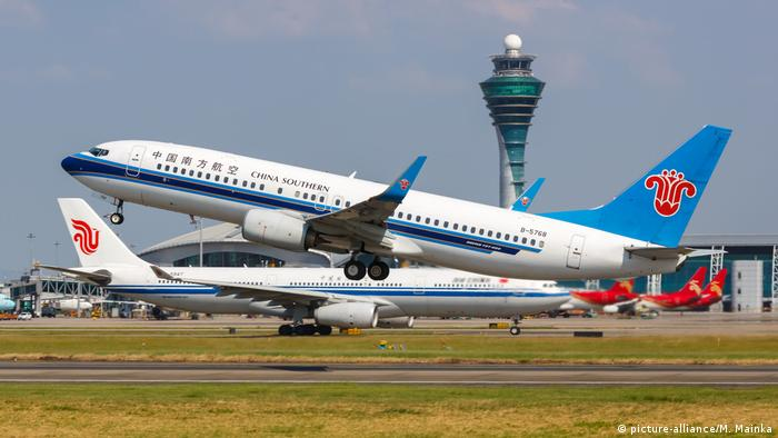 An airplane, type Flugzeug Boeing 737-800 taking off from the Guangzhou Bai Yun International Airport in China.