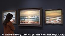 July 23, 2020, London, UK: LONDON, UK. A staff member views ''Mediterranean Sea View 2017 (2017) by Banksy, estimate: £800,000-1.2 million. Preview of works on display at Sotheby's London ahead of a one-off auction on July 28. Titled 'Rembrandt to Richter', the sale will offer the very best from Old Masters, Impressionist & Modern Art, Modern & Post-War British Art and Contemporary Art. The exhibition is open to the public at Sotheby's New Bond Street galleries until July 28. [Image embargoed for release until 9am BST 24 July 2020] (Credit Image: © Stephen Chung/London News Pictures via ZUMA Wire |