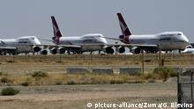 (far left) The last Australia's Qantas Boeing 747 pulls into its parking sport behind 3 other retired Qantas 747's Friday,Mojave CA/USA. July 24,2020. All the planes will be stripped for parts. (Credit Image: © Gene Blevins/ZUMA Wire |