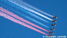 Su-25 jet fighters release smoke in the colours of the Russian state flag during the Navy Day parade in Saint Petersburg, Russia July 26, 2020. Dmitri Lovetsky/Pool via REUTERS