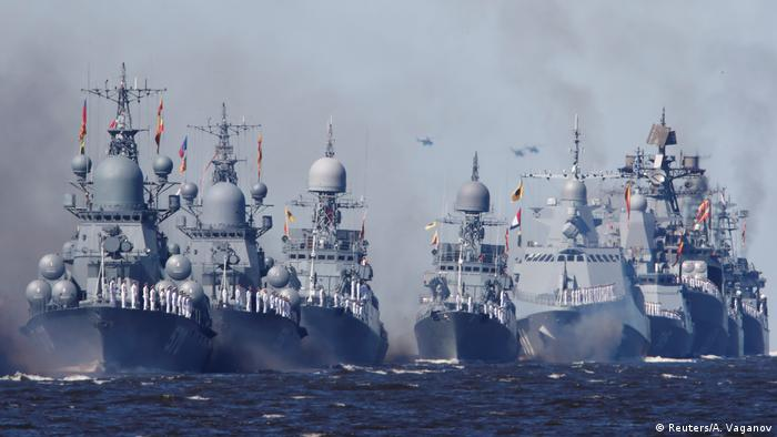 Russian warships sail during the Navy Day parade in Kronstadt near Saint Petersburg