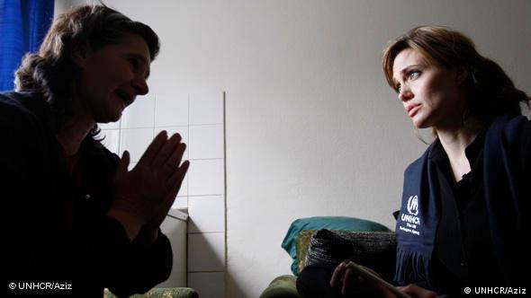 A Bosnian woman who was displaced from her home during the 1992-1995 war in the country talks to UNHCR Goodwill Ambassador, Angelina Jolie, during the actress' visit to a center for displaced in the eastern Bosnian town of Gorazde in April 2010