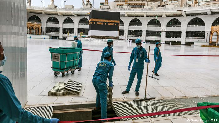 Workers at the Grand Mosque in Saudi Arabia's holy city of Mecca lay out lines to direct pilgrims