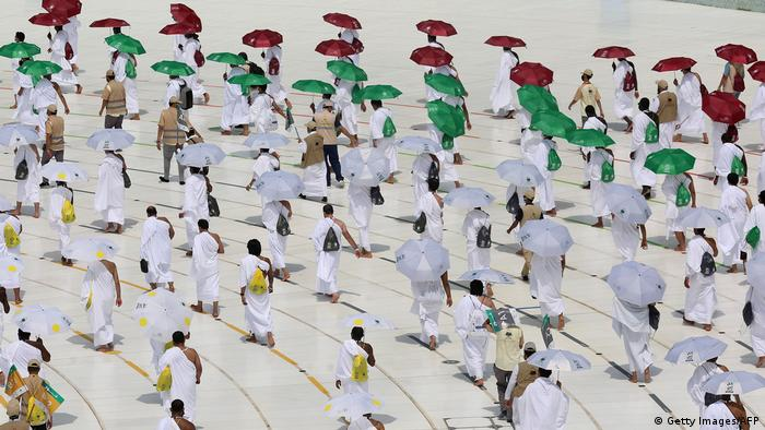 Pilgrims circumambulating around the Kaaba, Islam's holiest shrine, at the centre of the Grand Mosque in the holy city of Mecca