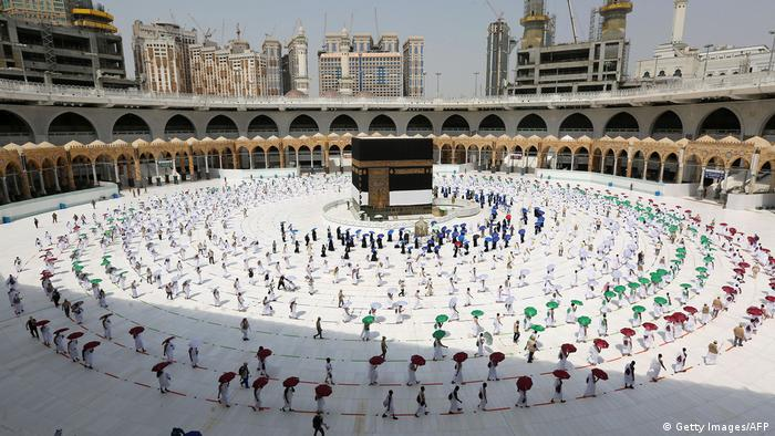Wide shot of pilgrims circumambulating around the Kaaba, Islam's holiest shrine