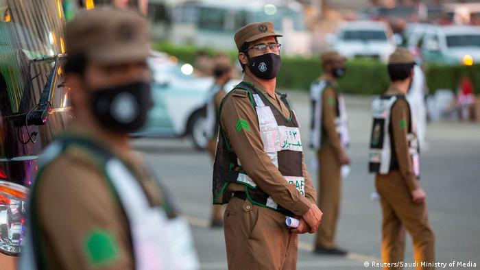 Security officers wear protective masks
