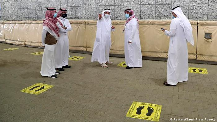 Saudi officials are seen where Muslim pilgrims head to cast stones at pillars symbolizing Satan
