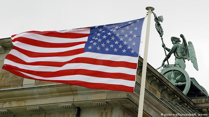 US flag in front of the Brandenburg Gate in Berlin