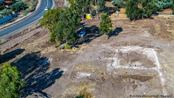 An aerial shot shows the outline of church foundations in the ground in Kfar Kama, Israel
