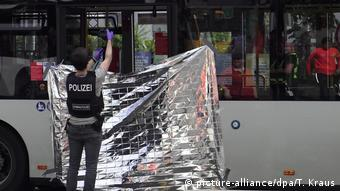 Police officer takes photographs at the bus where the attack took place. 27.07.2020 Bonn, Germany.