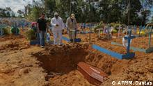 A coffin for a COVID-19 victim is burried in Brazil (AFP/M. Dantas)