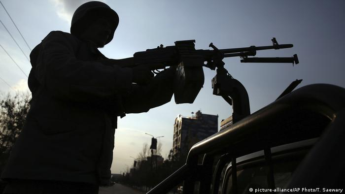An Afghan soldier fighting a gun