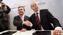 President of Renault SA and Nissan Motor Co., Carlos Ghosn, left, and President of Daimler AG, Dieter Zetsche shake hands after signing an agreement in Brussels, Wednesday April 7, 2010. The companies will link up and aim to bolster their offerings in small, energy efficient vehicles amid an industry slump that has ravaged the companies' earnings. (AP Photo/Virginia Mayo)