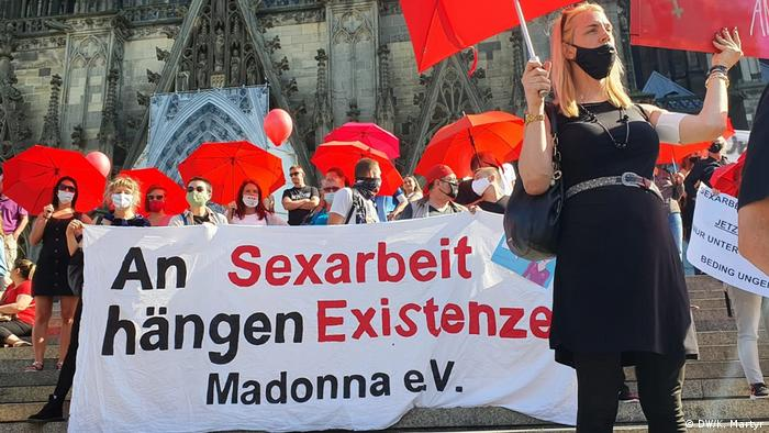 Demonstrators hold banners which read: 'Our existence depends on sex work'