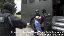 Belarusian KGB officers detain a Russian man in a sanitarium outside in Minsk, Belarus
