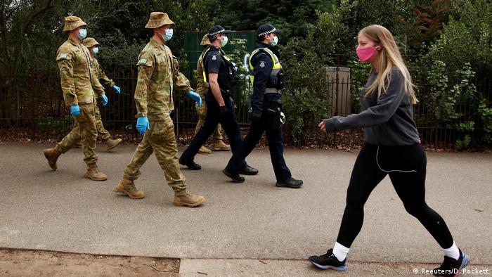 Police and soldiers patrol the streets (Reuters/D. Pockett)