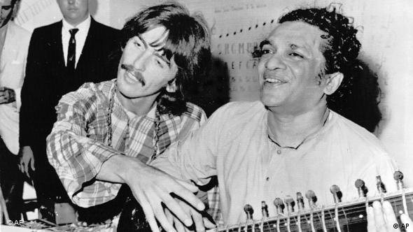 Beatle George Harrison, left, sits cross-legged with musical mentor Ravi Shankar of India, a sitar virtuoso, in Los Angeles, USA, Aug. 4, 1967. Harrison is being taught by Shankar how to play the sitar. (AP Photo)