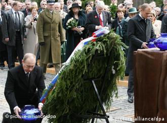 Russian PM Vladimir Putin laying a wreath at the Katyn memorial, western Russia