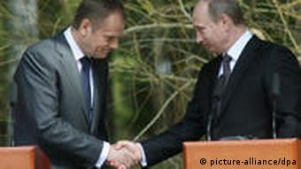 Poland's Prime Minister Donald Tusk and his Russian counterpart Vladimir Putin shake hands after giving statements in Katyn during a ceremony commemorating the 70th anniversary of the 1940 Katyn Massacre, 7 April 2010. 22,000 Polish officers, uniformed servicemen and intellectuals were executed by the Soviet NKVD in the nearby Katyn Forest.