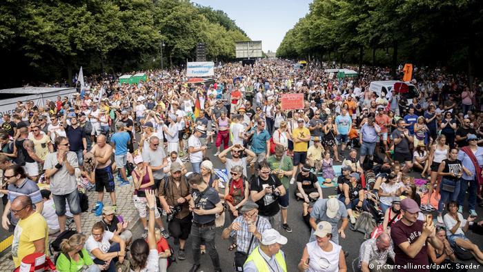 Demonstrators ignoring social distancing at protest in Berlin on August 1