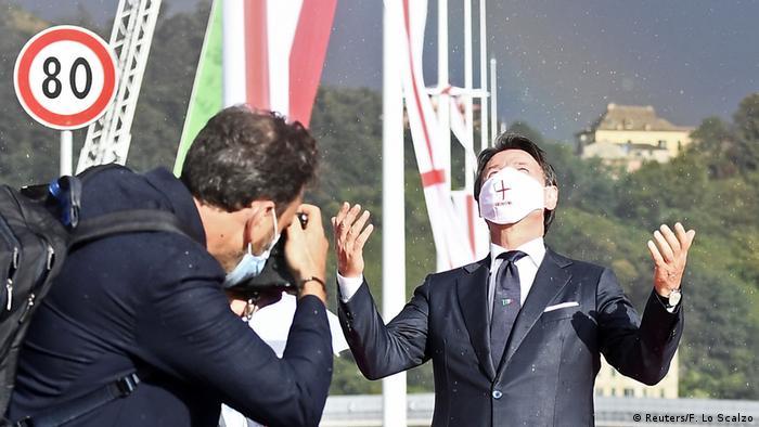Italian Prime Minister Giueseppe Conte poses on the new bridge (Reuters/F. Lo Scalzo)