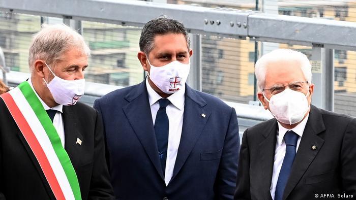 The mayor of Genoa, the President of Italy and the President of Liguria attend the opening of the bridge (AFP/A. Solaro)