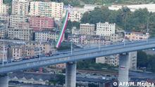 A view of the new San Giorgio bridge on the inauguration day on August 3 , 2020 in Genoa, the new high-tech structure will have four maintenance robots running along its length to spot weathering or erosion, as well as a special dehumidification system to limit corrosion. - Italy inaugurates a sleek new bridge in Genoa, though relatives of the 43 people killed when the old viaduct collapsed say the pomp and ceremony risk overshadowing the tragedy. (Photo by Miguel MEDINA / AFP)