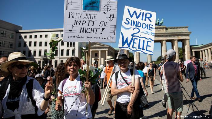 Protesters carry anti-coronavirus lockdown measure signs in Berlin