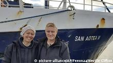 In this July 2020, photo supplied by Feeonaa and Neville Clifton, Neville and Feeonaa Clifton are pictured by the San Aotea II fishing boat in the Falkland Islands. The Cliftons, a honeymoon couple who were stranded on the remote Falkland Islands in March because of the coronavirus have managed to get home to New Zealand, Tuesday Aug. 4, 2020 by hitching a lift of more than 5,000 nautical miles (9,200 kilometers) on an Antarctic fishing boat. (Feeonaa/Neville Clifton via AP)  