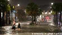 People walk through flooded streets (AFP/Getty Images/S. Rayford)