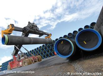 Pipes are loaded onto ship